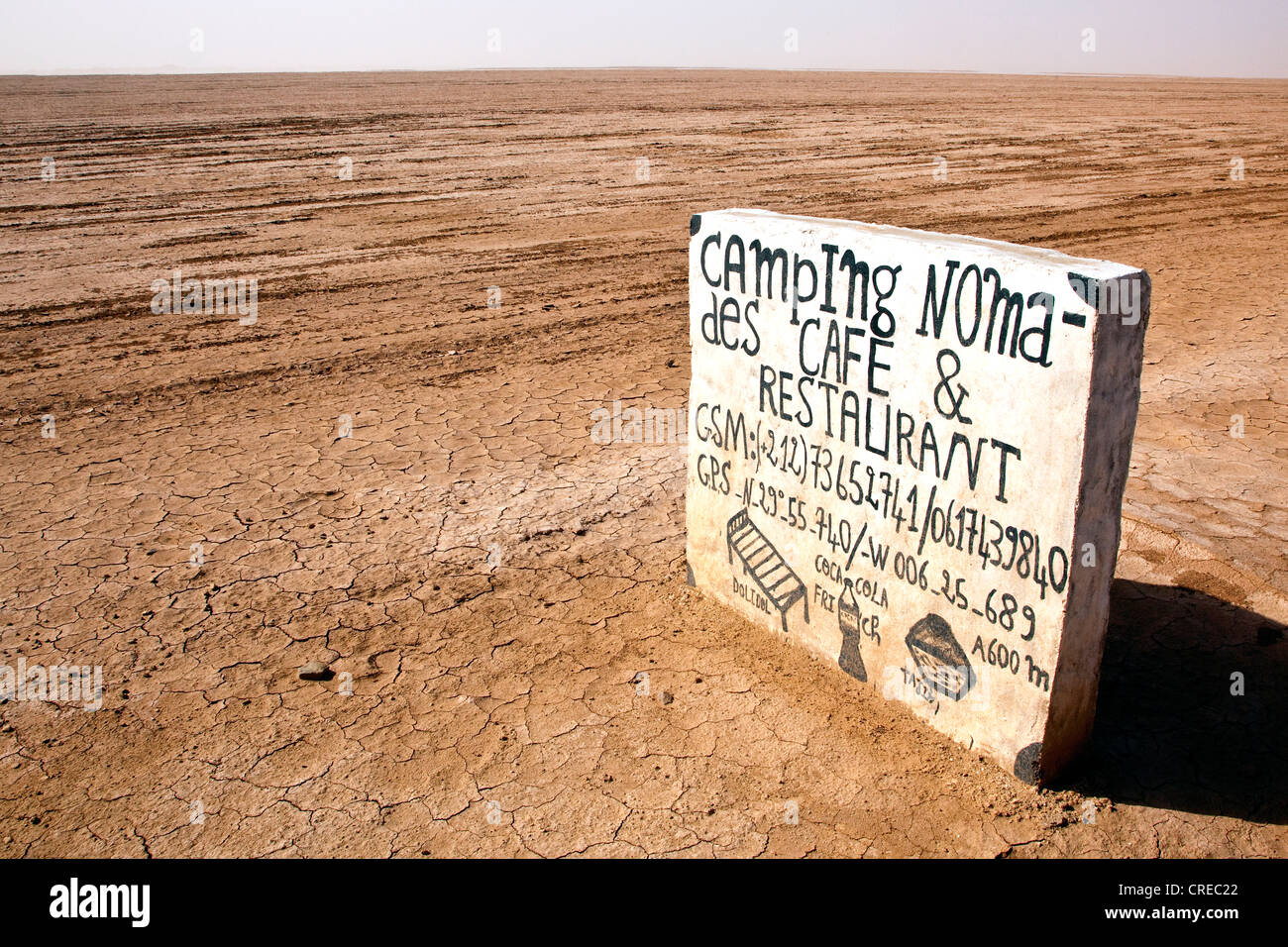 Sign for a camp site at the beginning of the Sahara Desert near Mhamid, Morocco, Africa - Stock Image