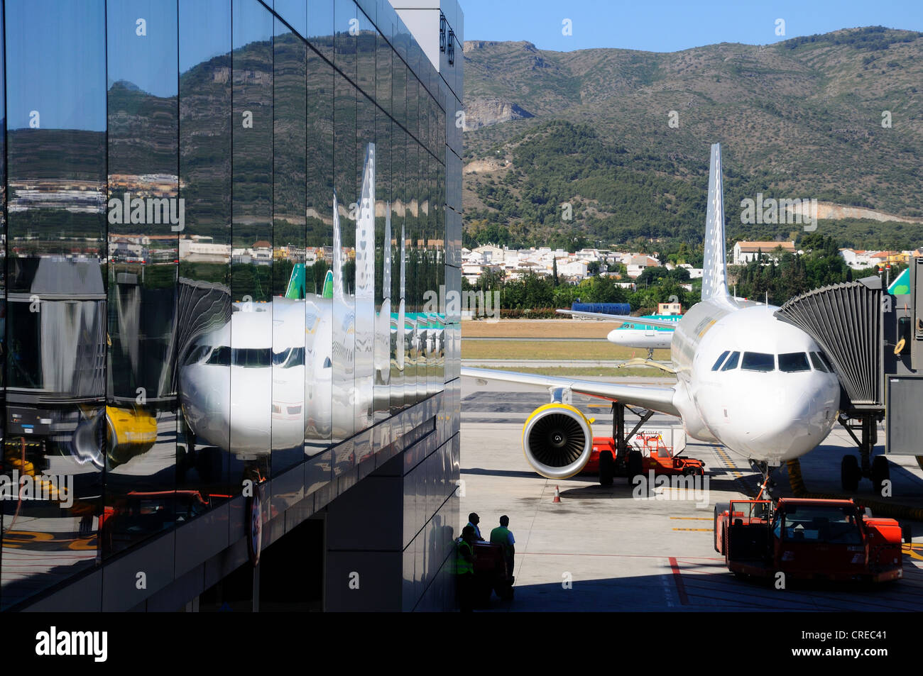 Vueling A-320 Aircraft reflected in glass sided terminal, Malaga Airport, Malaga, Andalusia, Spain, Western Europe. - Stock Image
