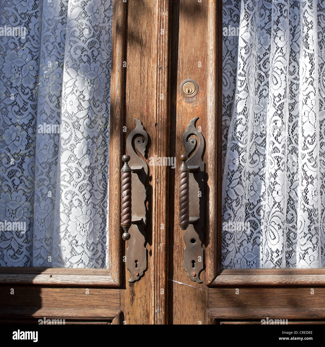 Lace curtains accent a wooden door in the Park Slope neighborhood of Brooklyn, New York. - Stock Image