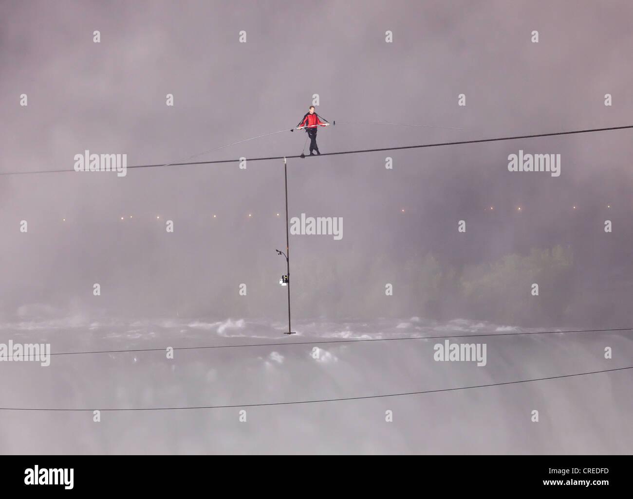 Nik Wallendar on his high wire walk over Niagara Falls for Goat Island Niagara,New York Sate to Niagara Falls in - Stock Image