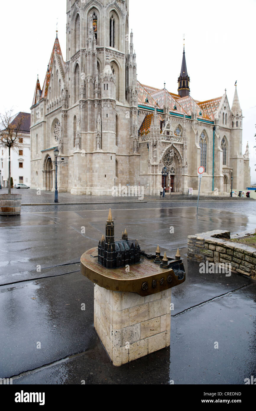 Matyas Church and a scale model in the foreground for the benefit of tourists seen in rain at the castle district - Stock Image