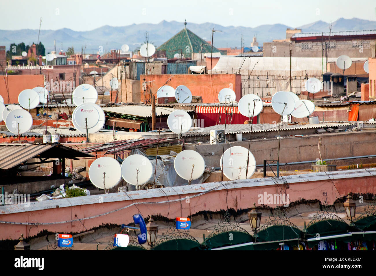 Satellite dishes and aerials on the roofs of buildings in the medina or old town of Marrakech, Morocco, Africa - Stock Image