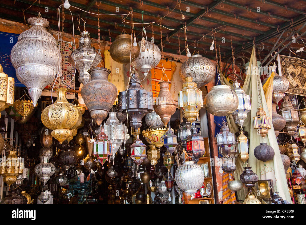 Moroccan lamps and lanterns made of sheet metal and wrought iron in the souk, market, in the Medina - Stock Image