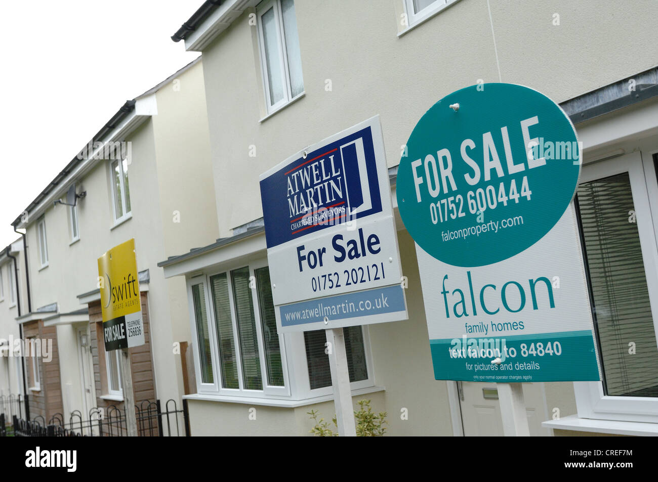 New houses and house for sale signs at The Limes in Plymouth Devon - Stock Image
