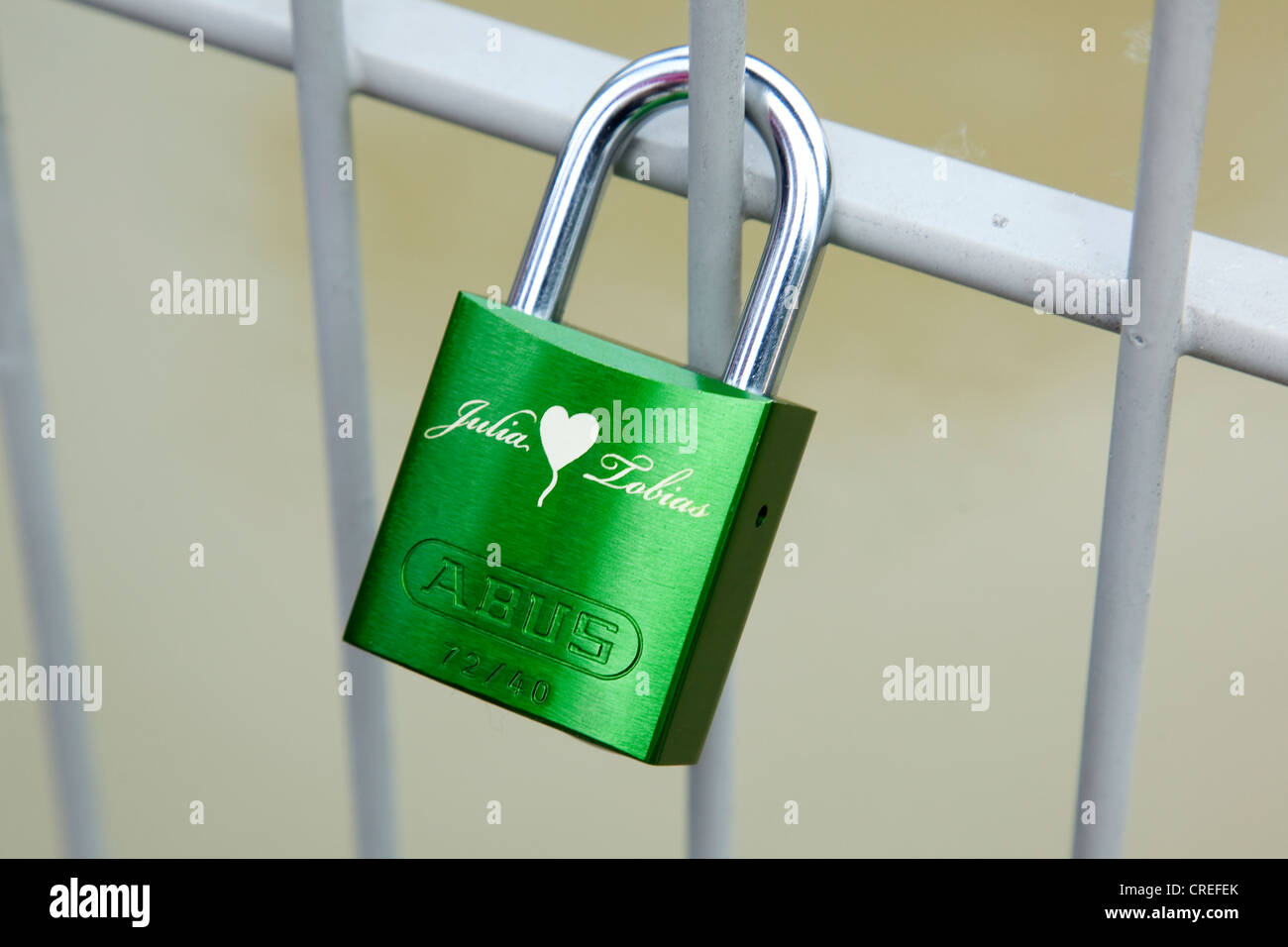 Padlock as a symbol of friendship and love of a married couple on a bridge in Regensburg, Bavaria, Germany, Europe - Stock Image