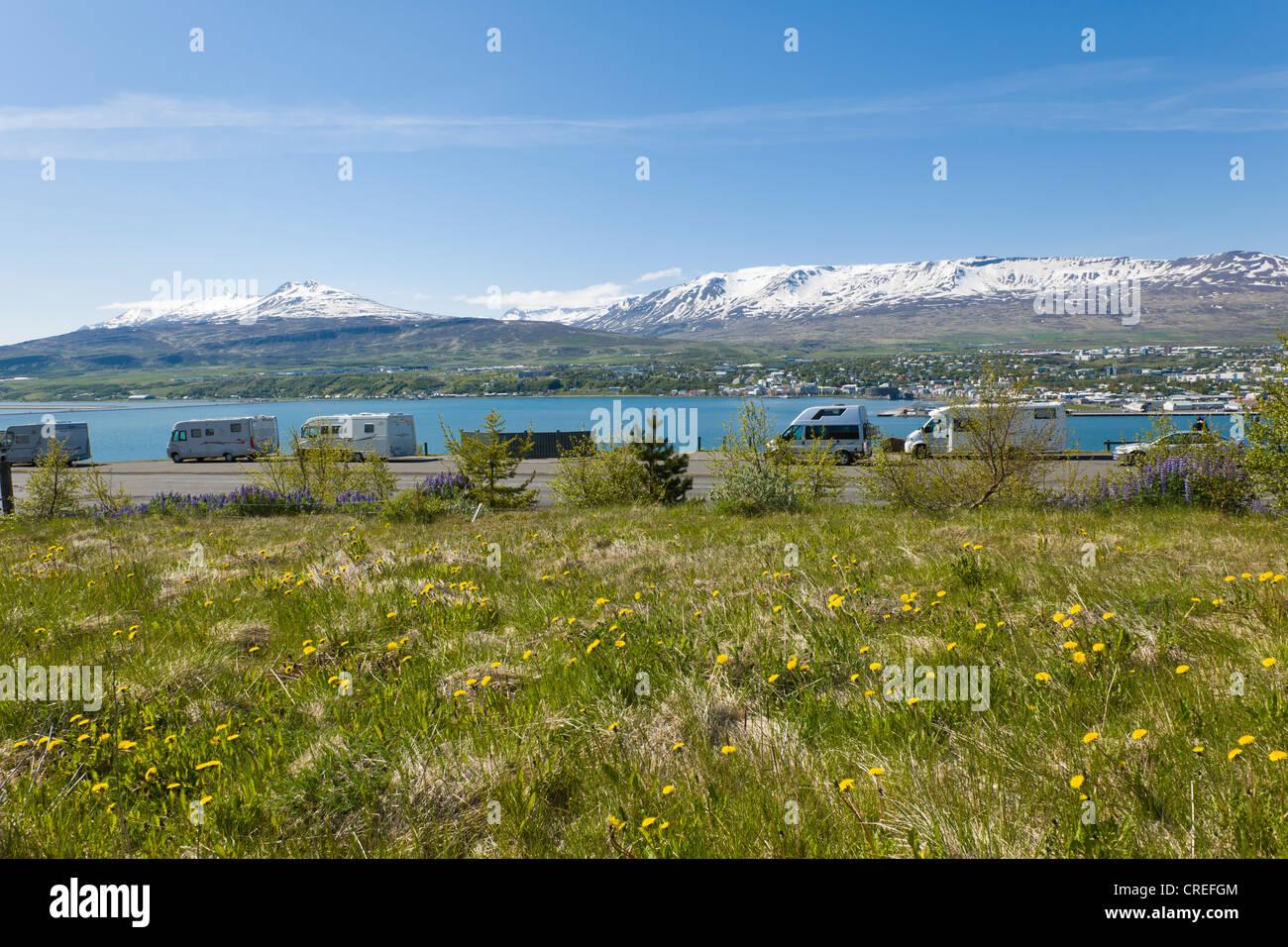 Camper vans on Eyjafjoerdur overlooking the town of Akureyri, Northern Iceland, Iceland, Northern Europe, Europe - Stock Image