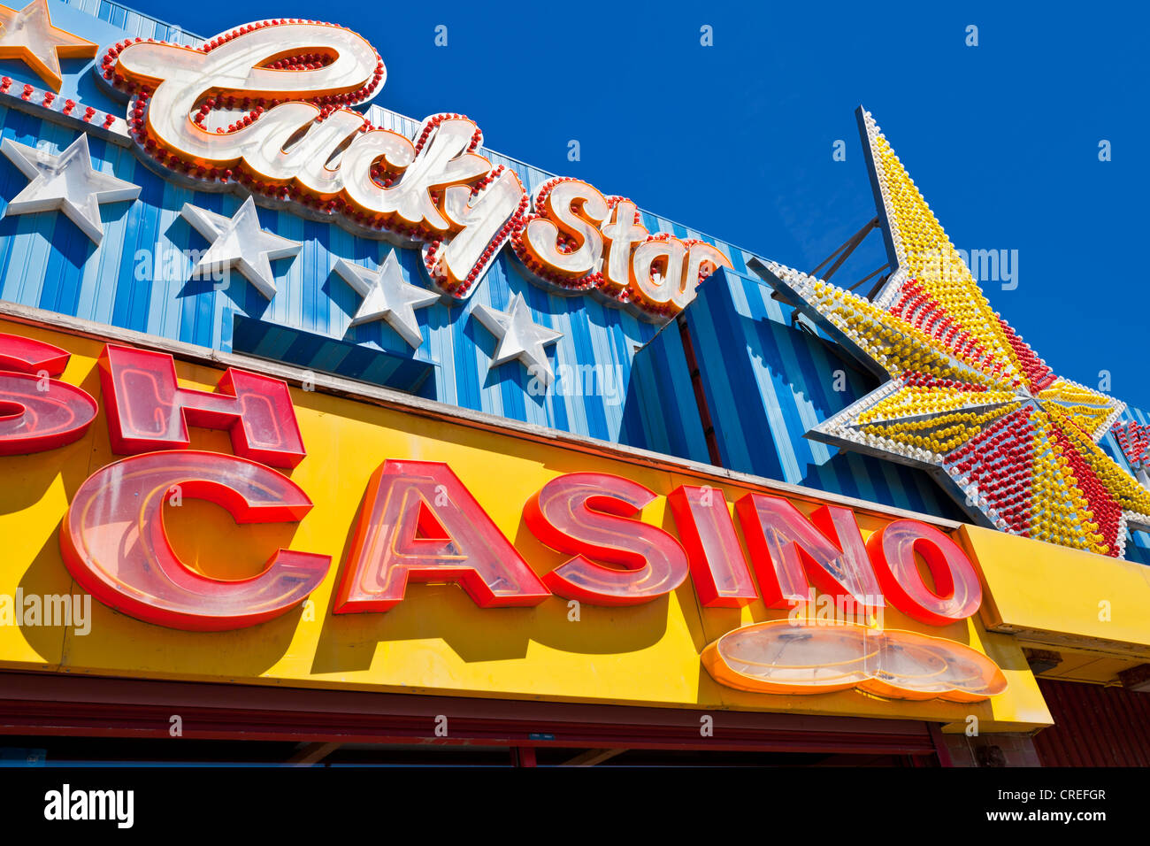 Lucky star casino and amusement arcade sign neon lights Blackpool promenade golden mile Lancashire England UK GB - Stock Image