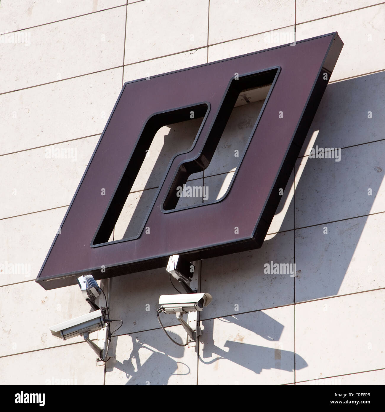 Logo with observation cameras on the IKB headquarters, Deutsche Industriebank AG, Duesseldorf, North Rhine-Westphalia - Stock Image
