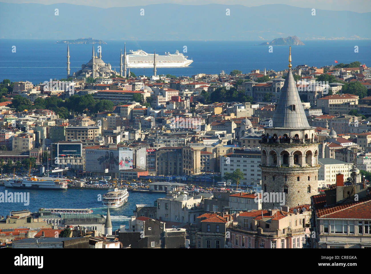 ISTANBUL, TURKEY. A view of the city from Beyoglu, with the Galata Tower on the right and the Blue Mosque in the - Stock Image