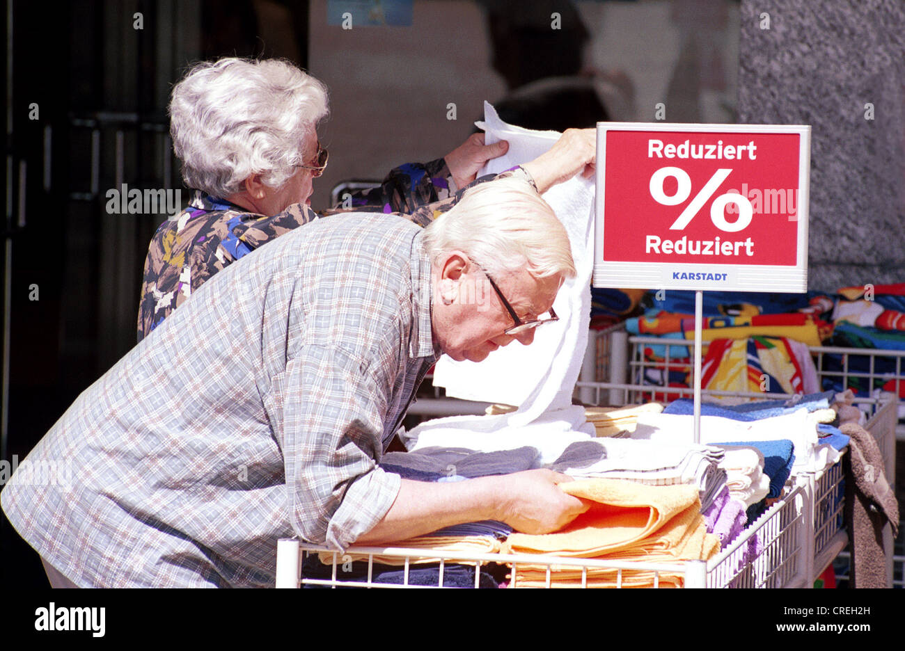 Couple considered reduced towels, Herne, Germany - Stock Image