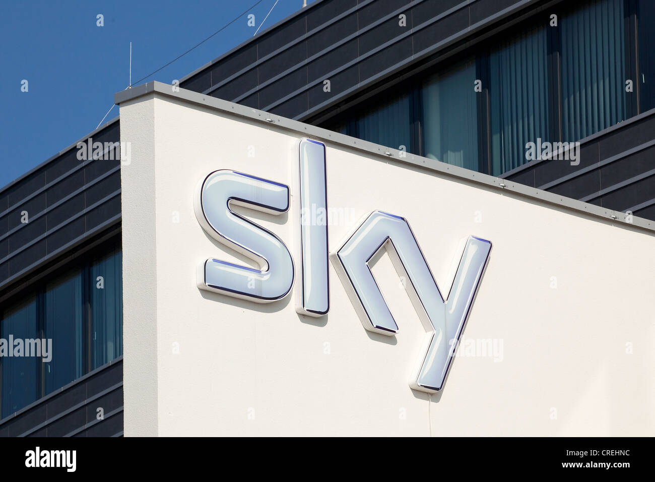 Logo at the head office of the pay-TV channel Sky Deutschland AG in Unterfoehring near Munich, Bavaria, Germany, - Stock Image