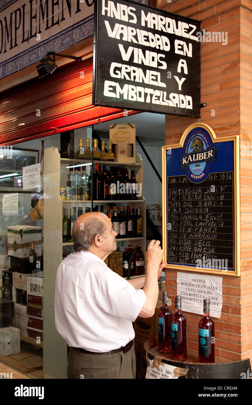 Wine merchants in the market hall, Mercado de Triana, Seville, Andalucia, Spain, Europe - Stock Image
