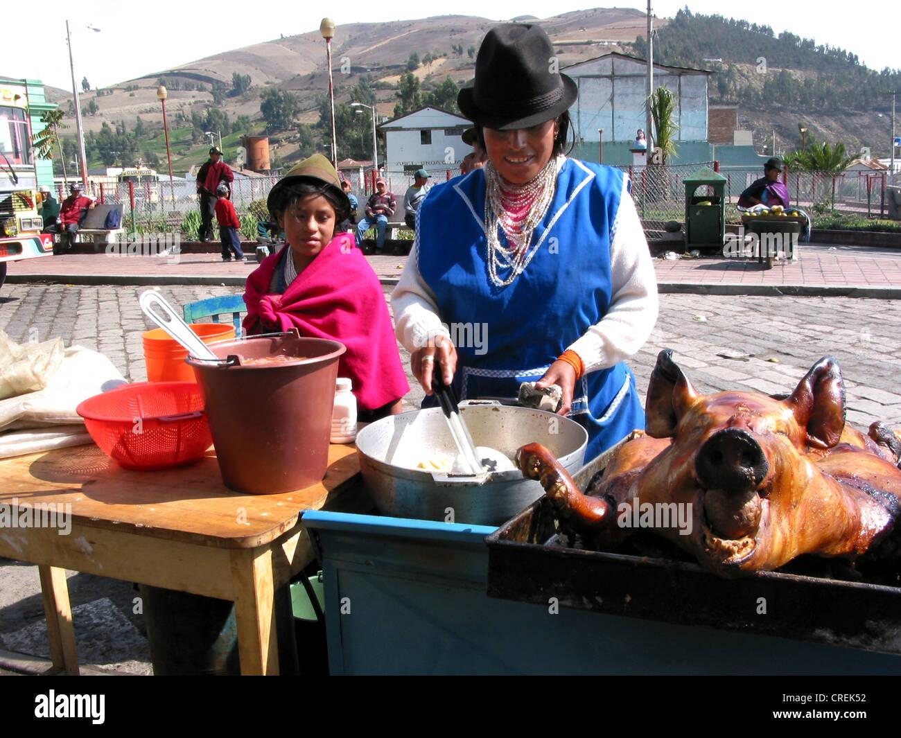 Kichwa woman sells pork in Guamote, Ecuador, Chimborazo, Andes, Guamote - Stock Image