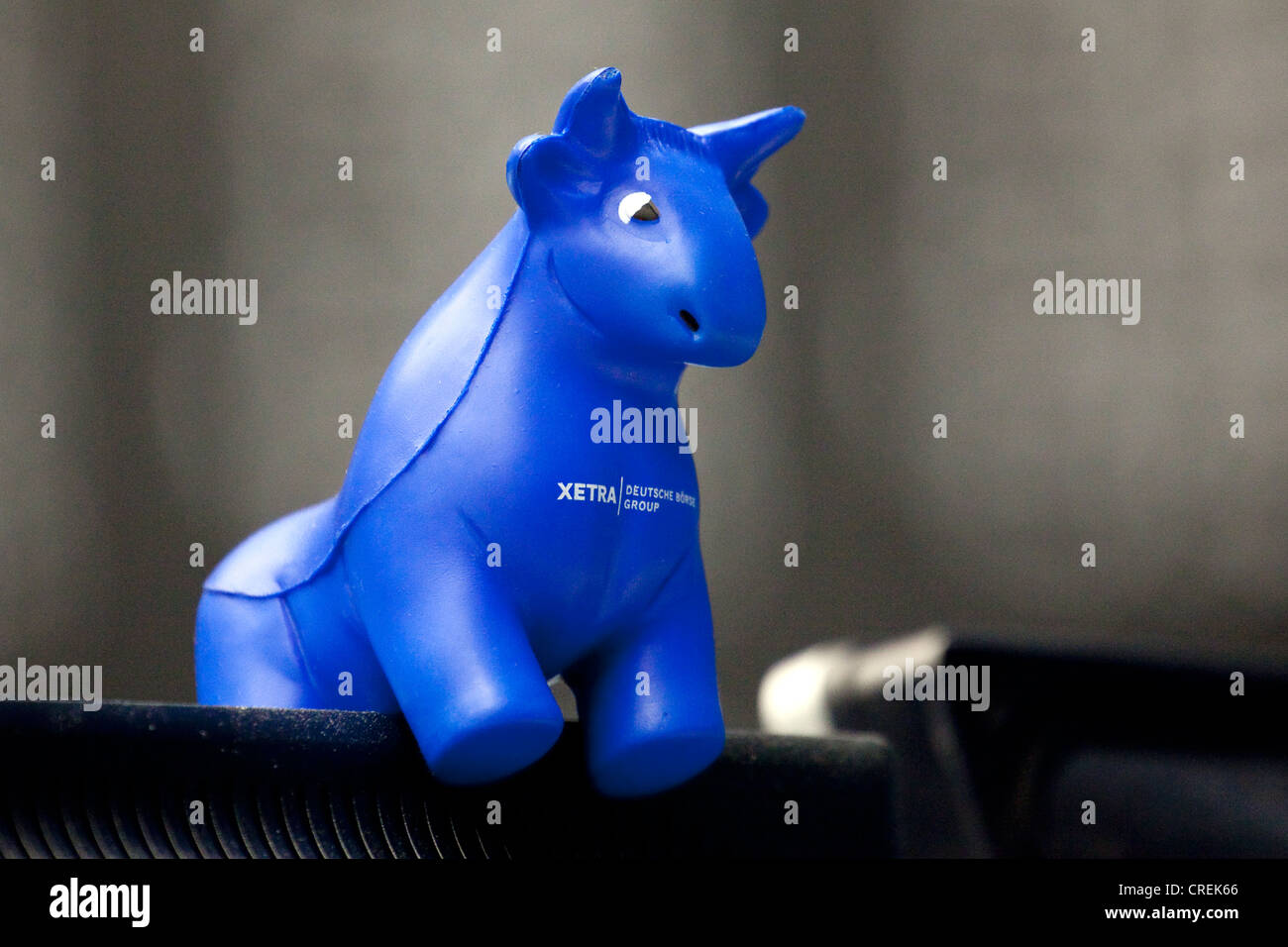 Figure of a bull standing on a screen of a stock trader on the trading floor of Frankfurt Stock Exchange, Deutsche - Stock Image