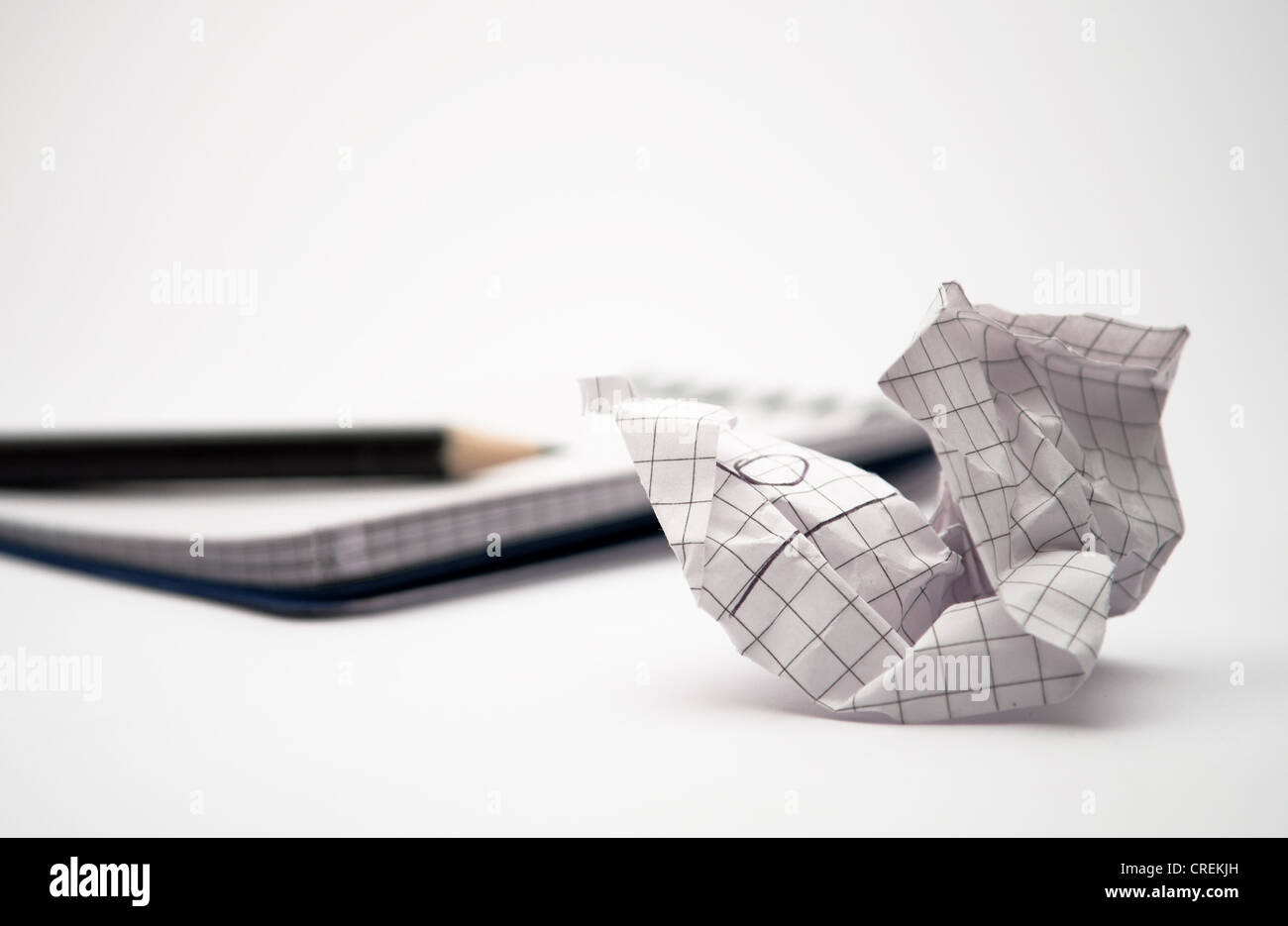 notebook with black pencil and paper - Stock Image