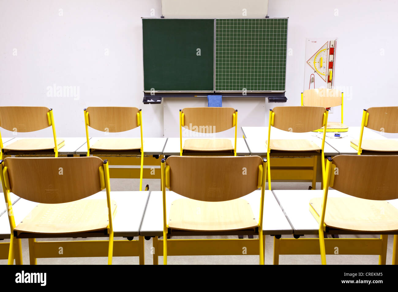 Chairs on desks in a classroom in a school in Straubing, Bavaria, Germany, Europe - Stock Image