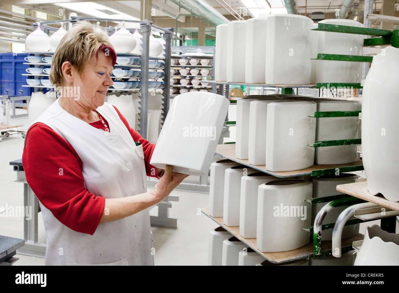 Employee during the final inspection of Rosenthal vases, in the production of tableware at the porcelain manufacturer - Stock Image
