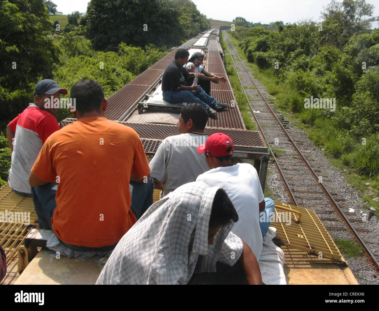 Illegal immigrants from Central America on the roof of the deathtrain through Mexico to the USA, Mexico Stock Photo