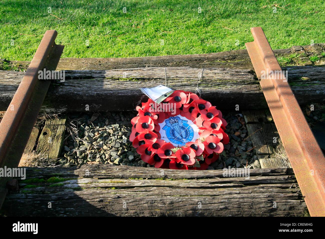 Burma Railway memorial poppy wreath National Memorial Arboretum Alrewas Staffordshire England UK - Stock Image