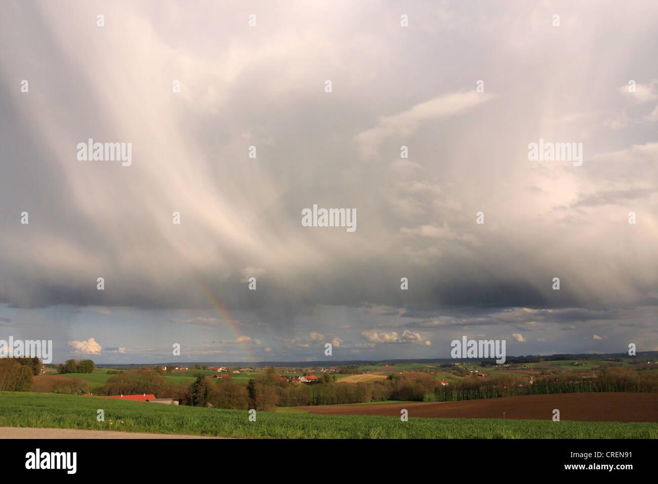dark rain clouds and rain bow over the alpine upland, Germany, Bavaria, Oberbayern, Upper Bavaria Stock Photo