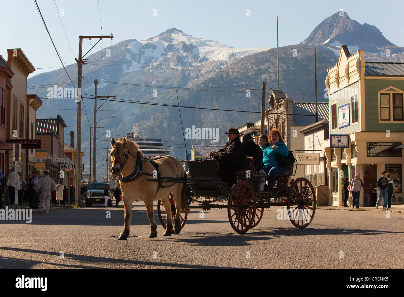 Horse-drawn carriage in historic Skagway, Broadway, Pacific ocean coast, White Pass, southeast Alaska, USA, Amerika - Stock Image