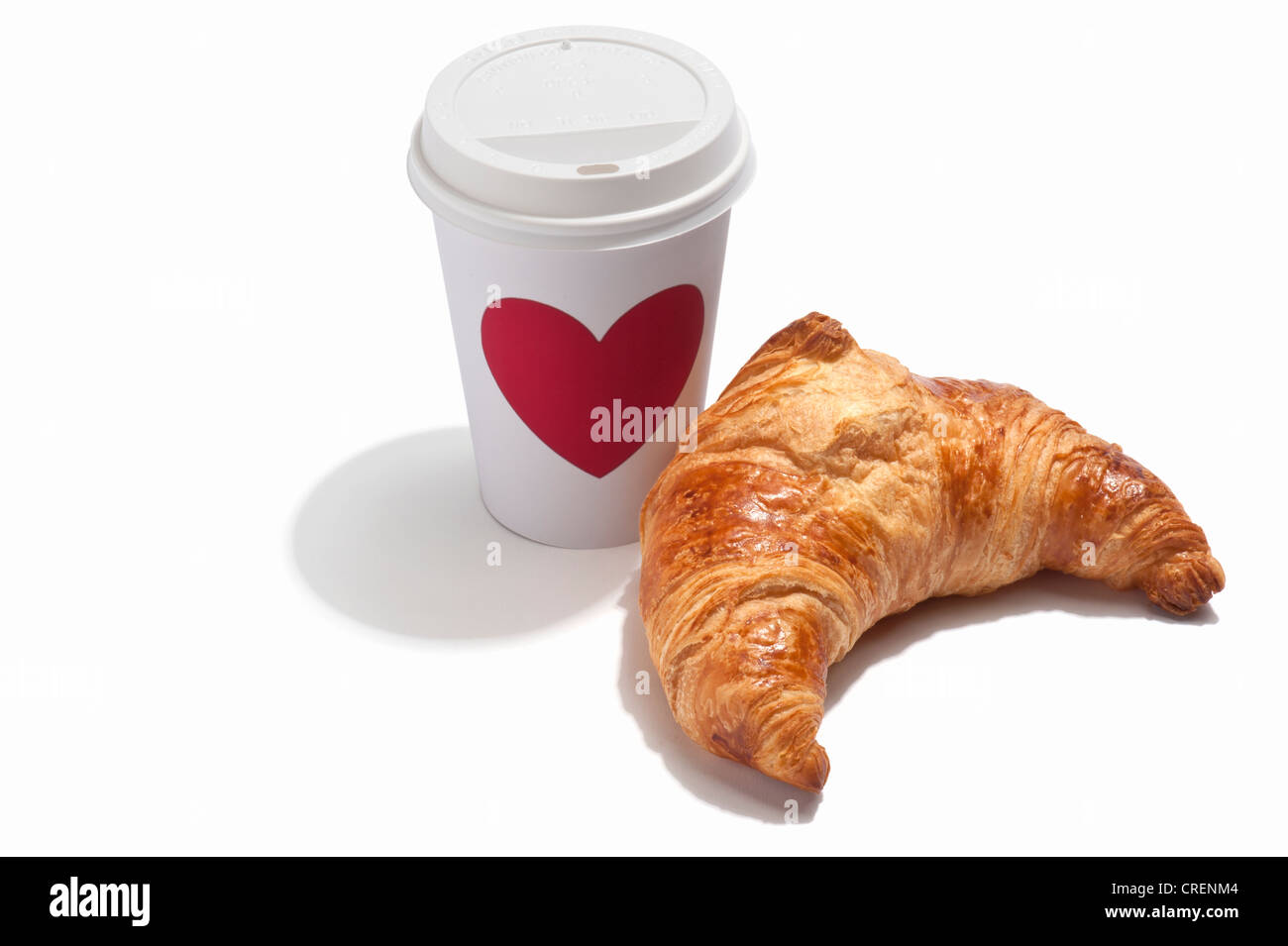 A croissant and a takeaway drink cup Stock Photo