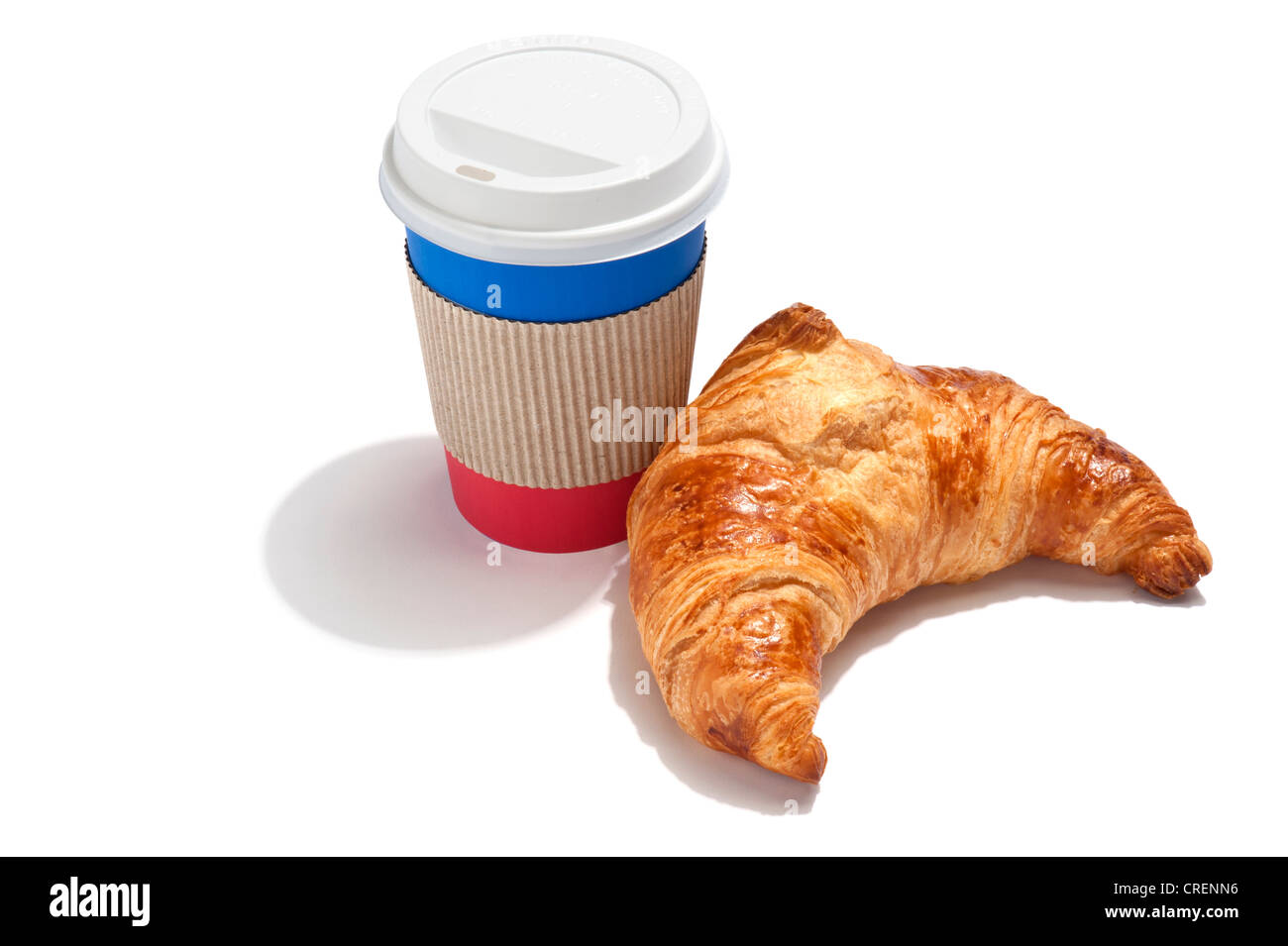 A croissant and a takeaway drink cup - Stock Image