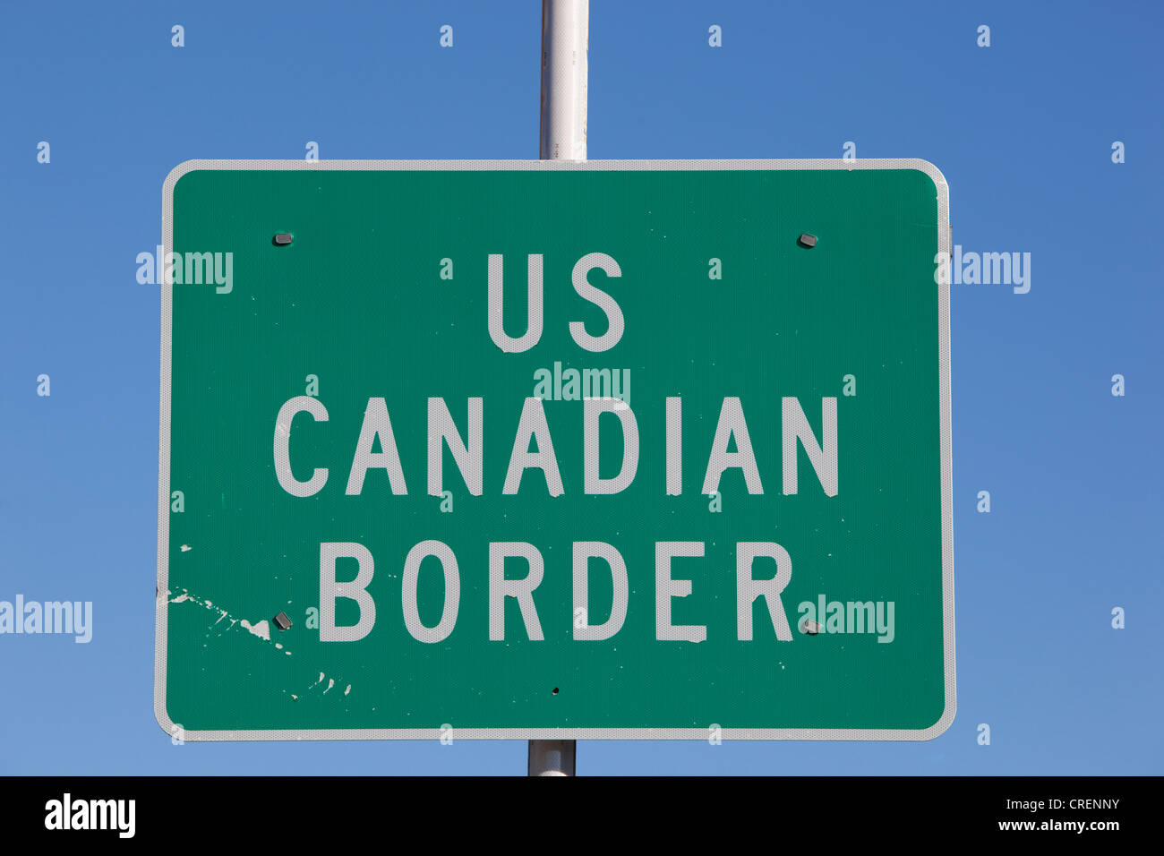 US - Canadian border crossing sign, White Pass, south Klondike Highway, Alaska and British Columbia, B. C., Canada - Stock Image