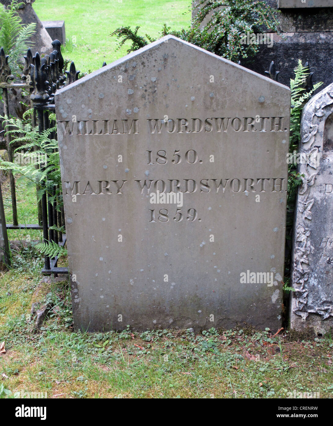 WILLIAM WORDSWORTH (1770-1850)  Gravestone of  Wordsworth and wife at St. Oswald's Church, Grasmere, Cumbria. - Stock Image