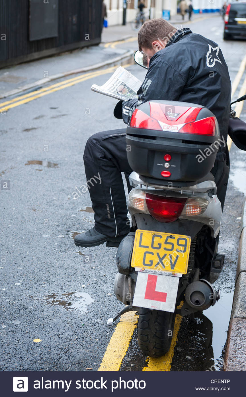 London  Great Eastern Street  Honda bike scooter L plates messenger parked double yellow line reading news paper newspaper & London  Great Eastern Street  Honda bike scooter L plates ...