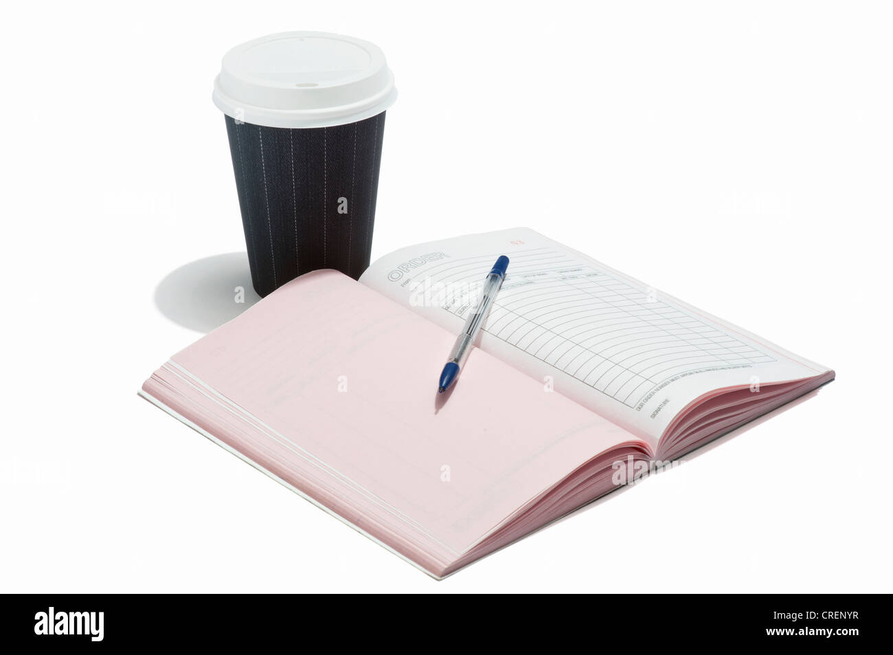 A takeaway drink cup with order book and pen - Stock Image
