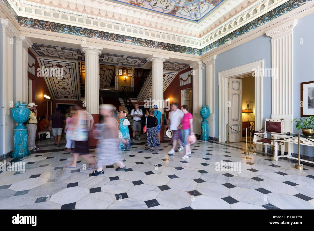 Visitors inside the Achillion Palace near Gastouri, eastern Corfu, Corfu Island, Ionian Islands, Greece, Southern - Stock Image