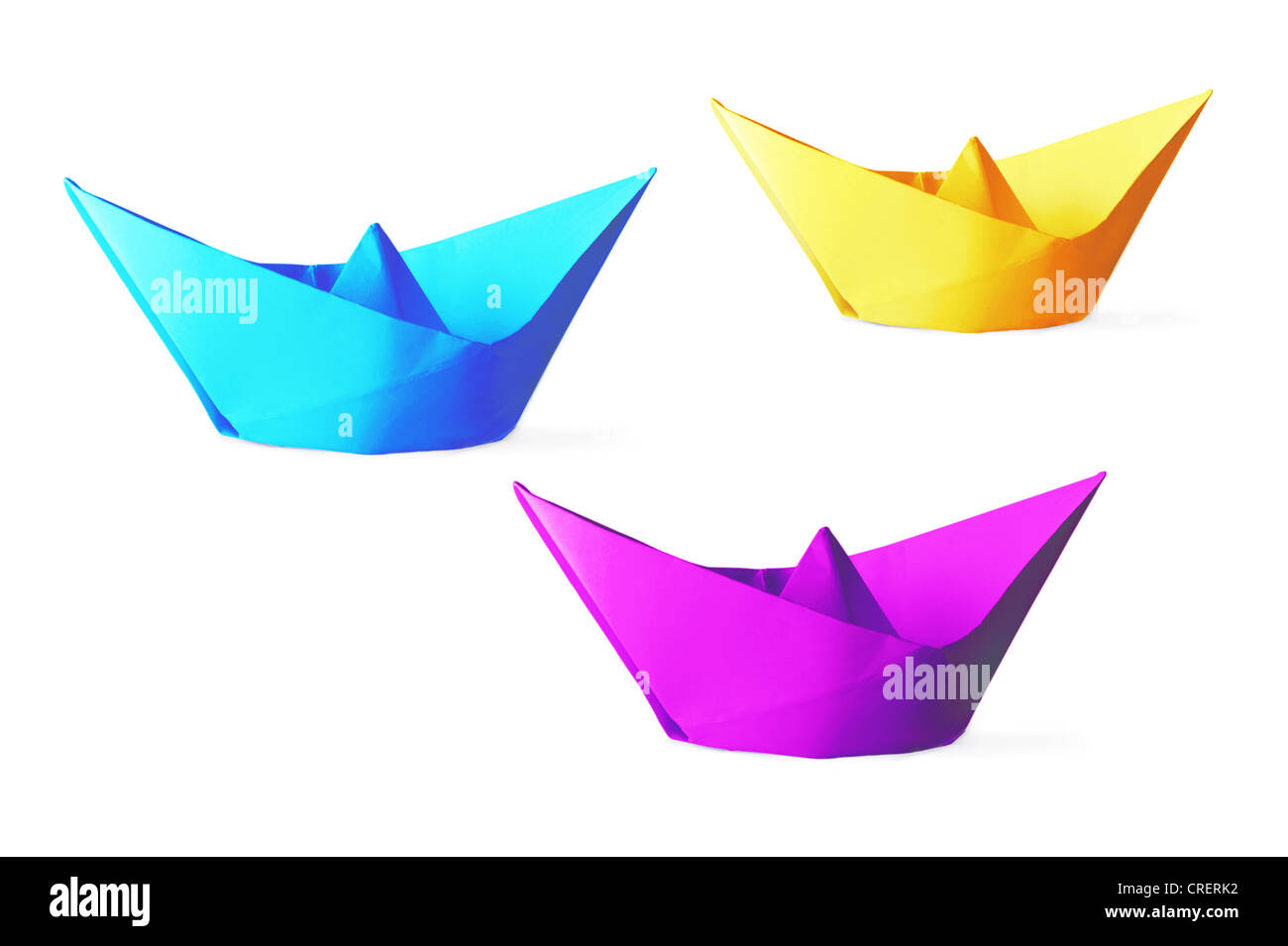 Colorful paper ships isolated on a white background - Stock Image