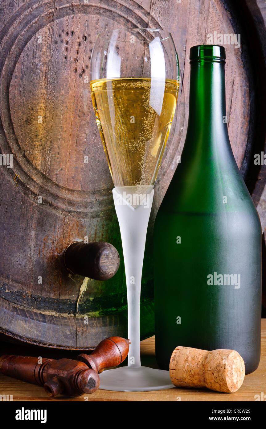 Still life with glass and bottle of italian prosecco - Stock Image