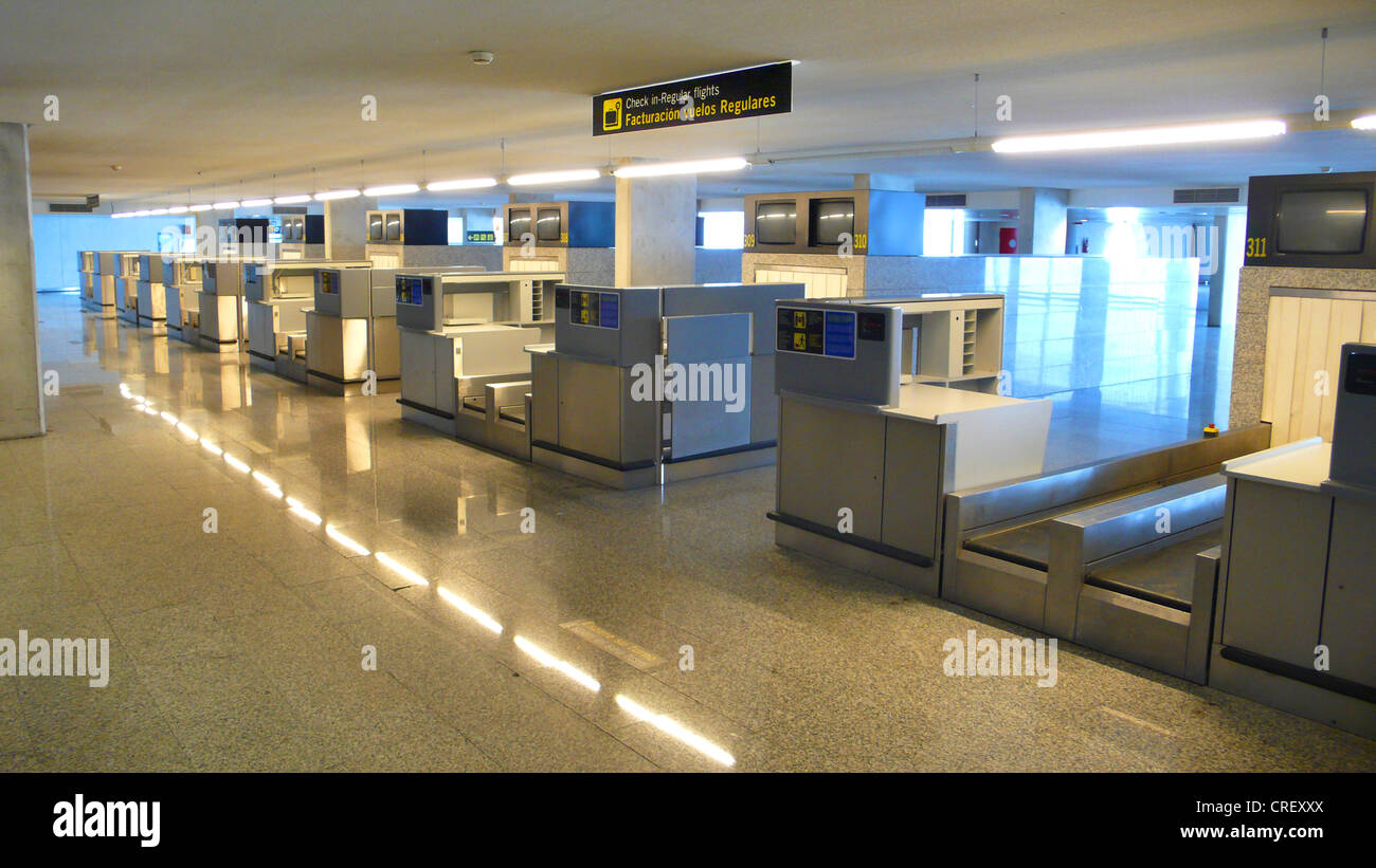 empty baggage counters at airport - Stock Image