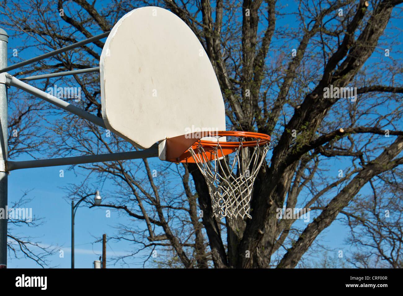 Basketball hoop and net on white backboard - Stock Image