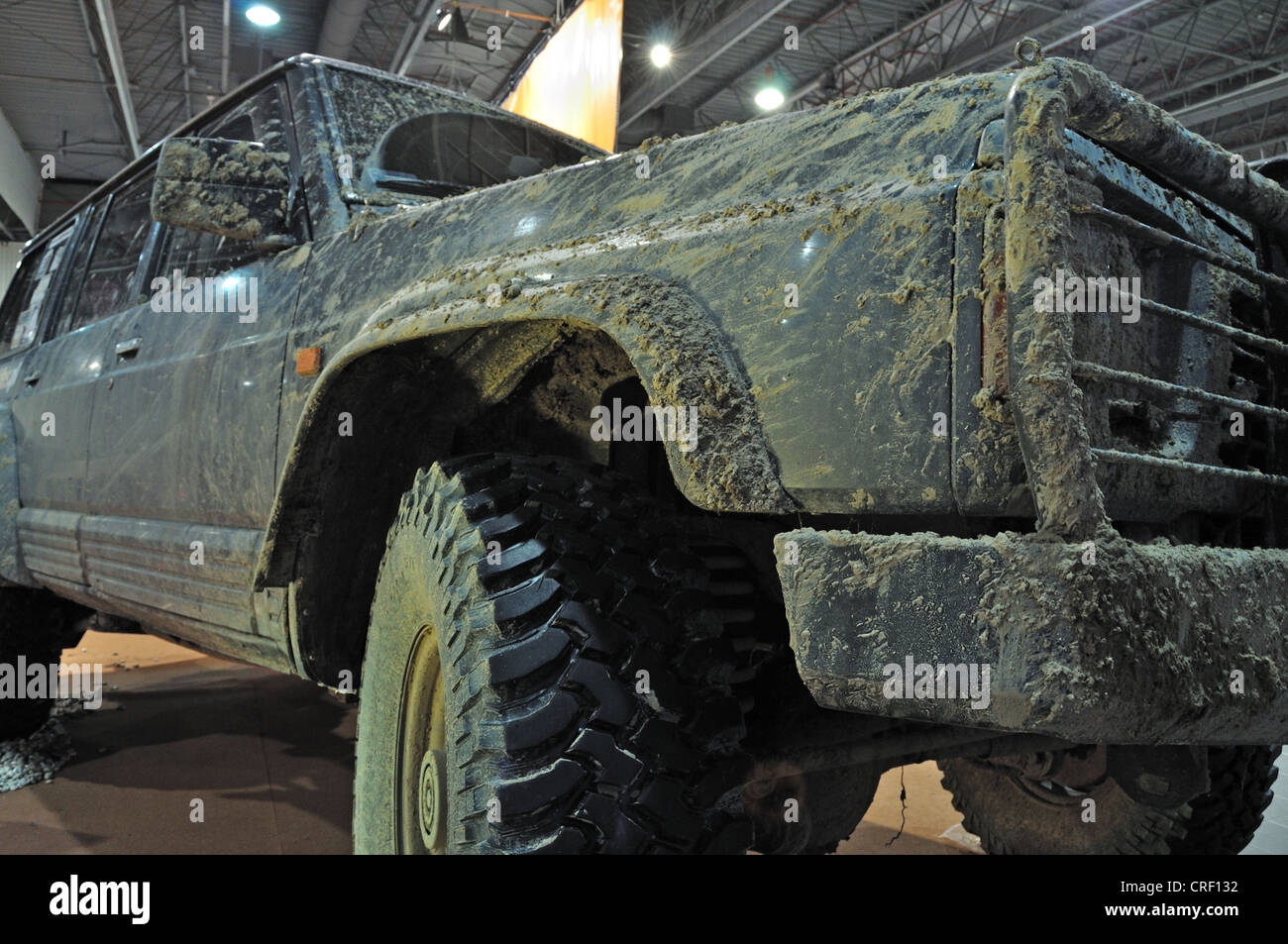 Mud-covered Sport Utility Vehicle - Stock Image