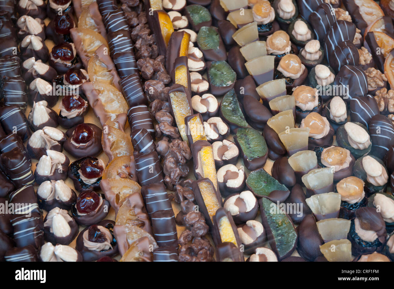 Hand-crafted chocolates displayed in the window of a confectioner in Munich - Stock Image