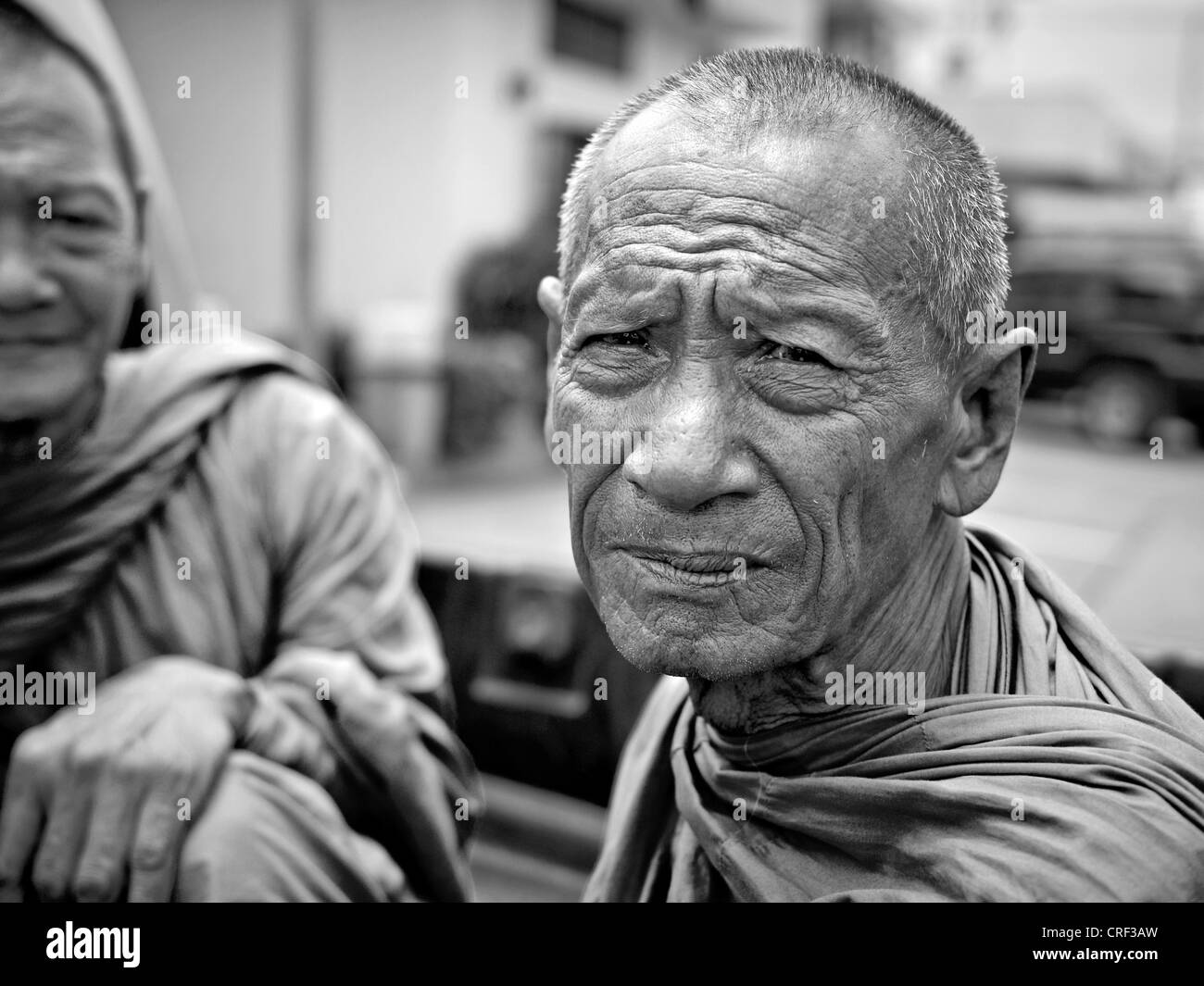 Black and white photography portrait of an elderly Buddhist monk. Thailand S.E. Asia - Stock Image