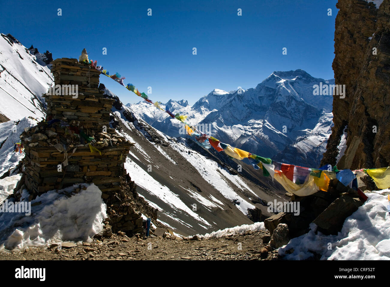 STONE CHORTEN and ANNAPURNA THREE at 7553 meters as seen from the KANG LA PASS on the NAR PHU TREK, Nepal, Annapurna - Stock Image