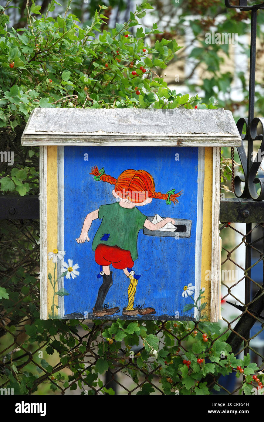 Pippi Longstocking drop a letter - painting on mailbox, Sweden, Smaland, Vimmerby - Stock Image
