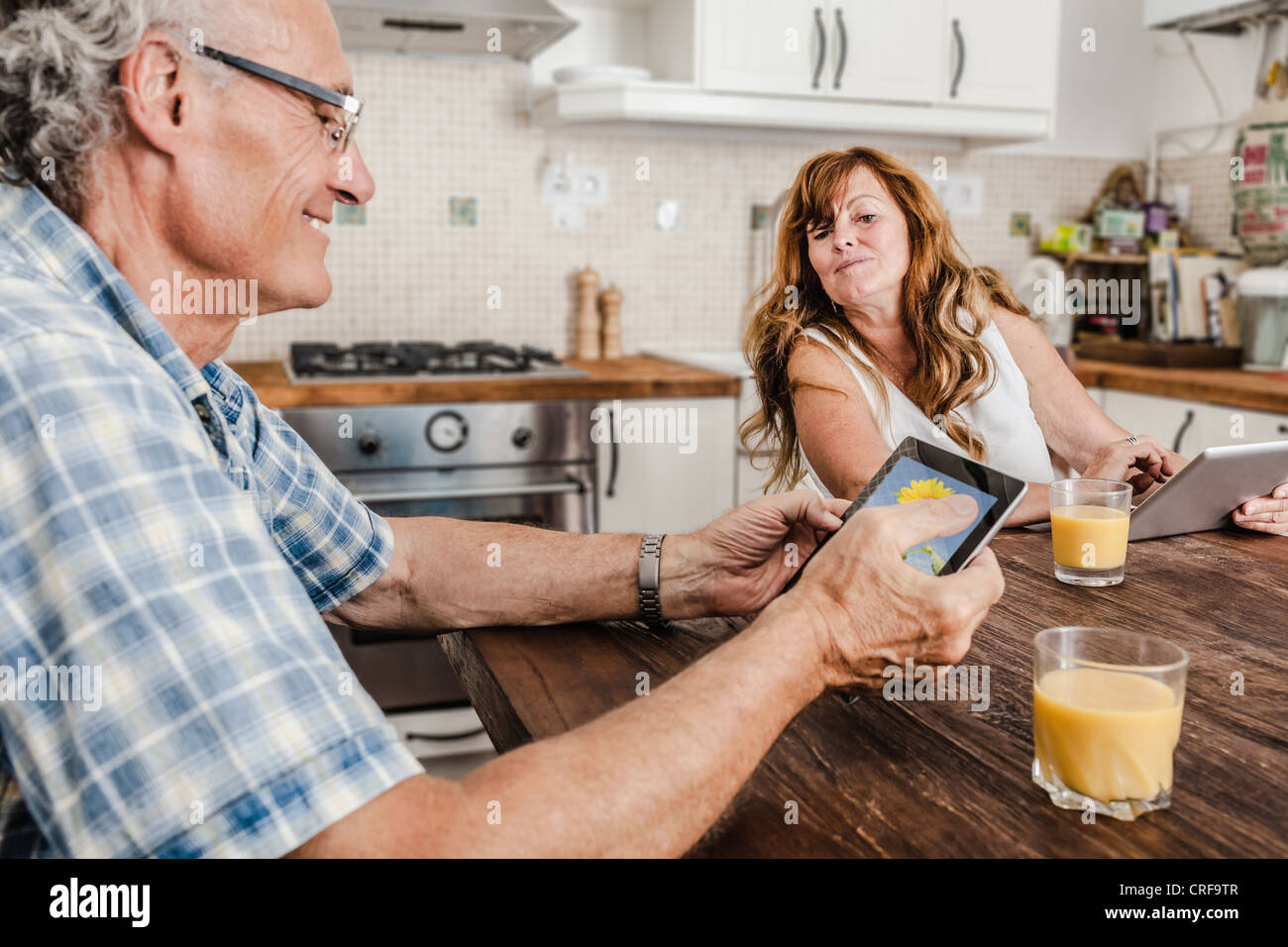 Older couple using tablet computers - Stock Image