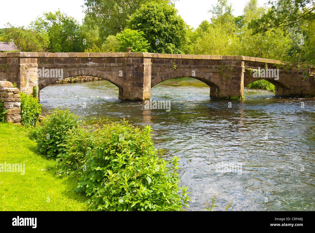 Holme Bridge, Bakewell, a packhorse bridge over the River Wye - Stock Image