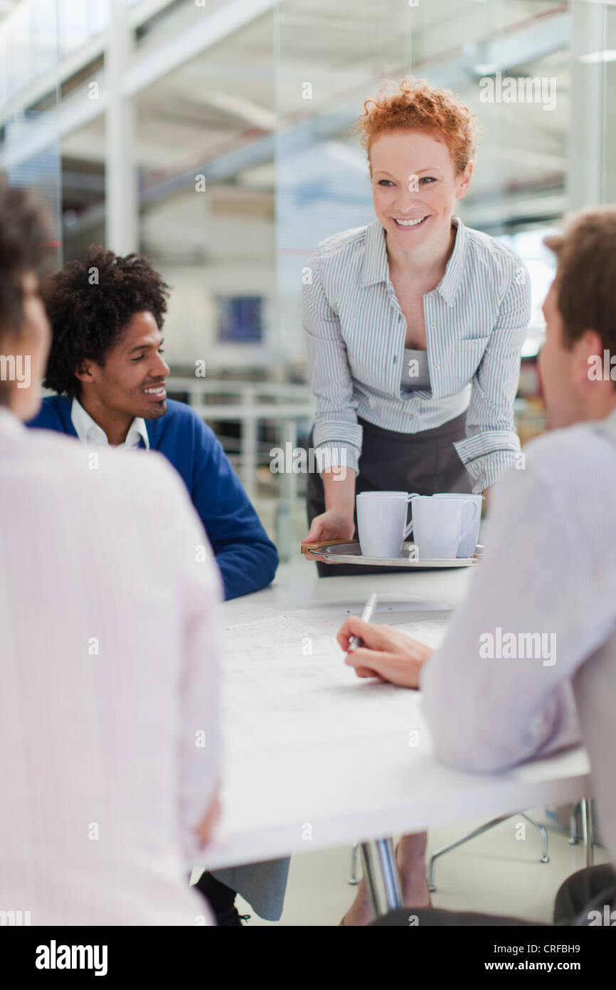 Businesswoman with tray of coffee - Stock Image