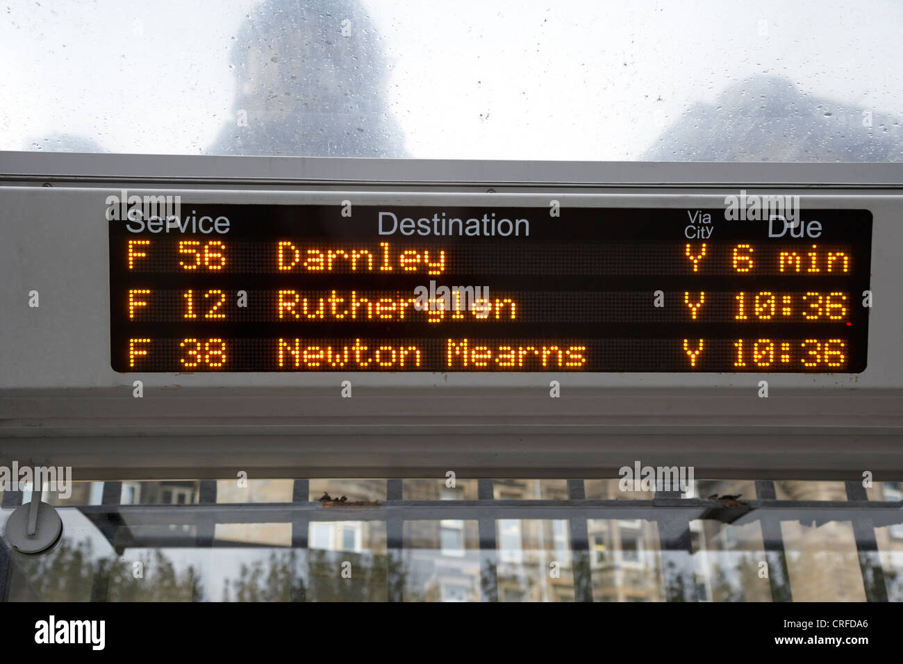 electronic bus timetable in central glasgow scotland uk - Stock Image