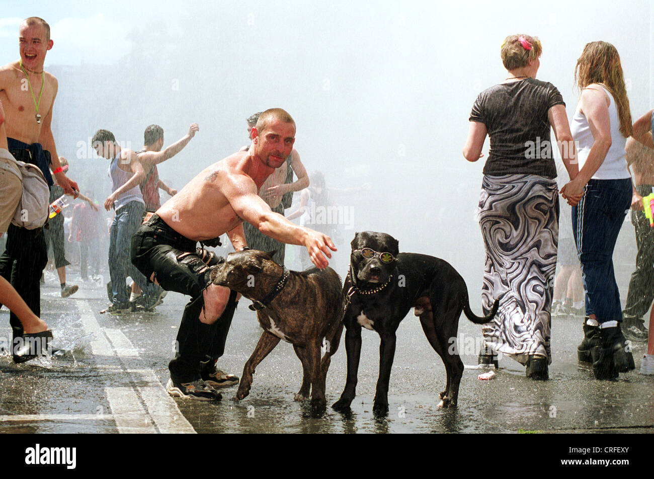 Berlin, Germany, A Young Man With Dogs In The Shower At The Love Parade