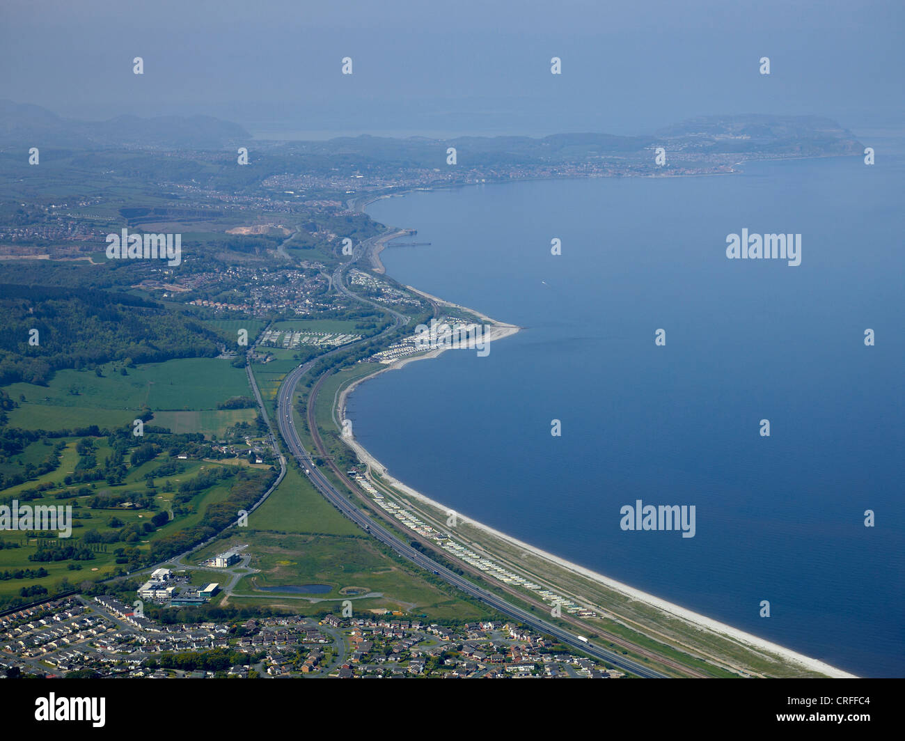 North Wales Coast nr Abergele, looking towards Colwyn Bay, showing the A55 and Great Orme in the distance - Stock Image