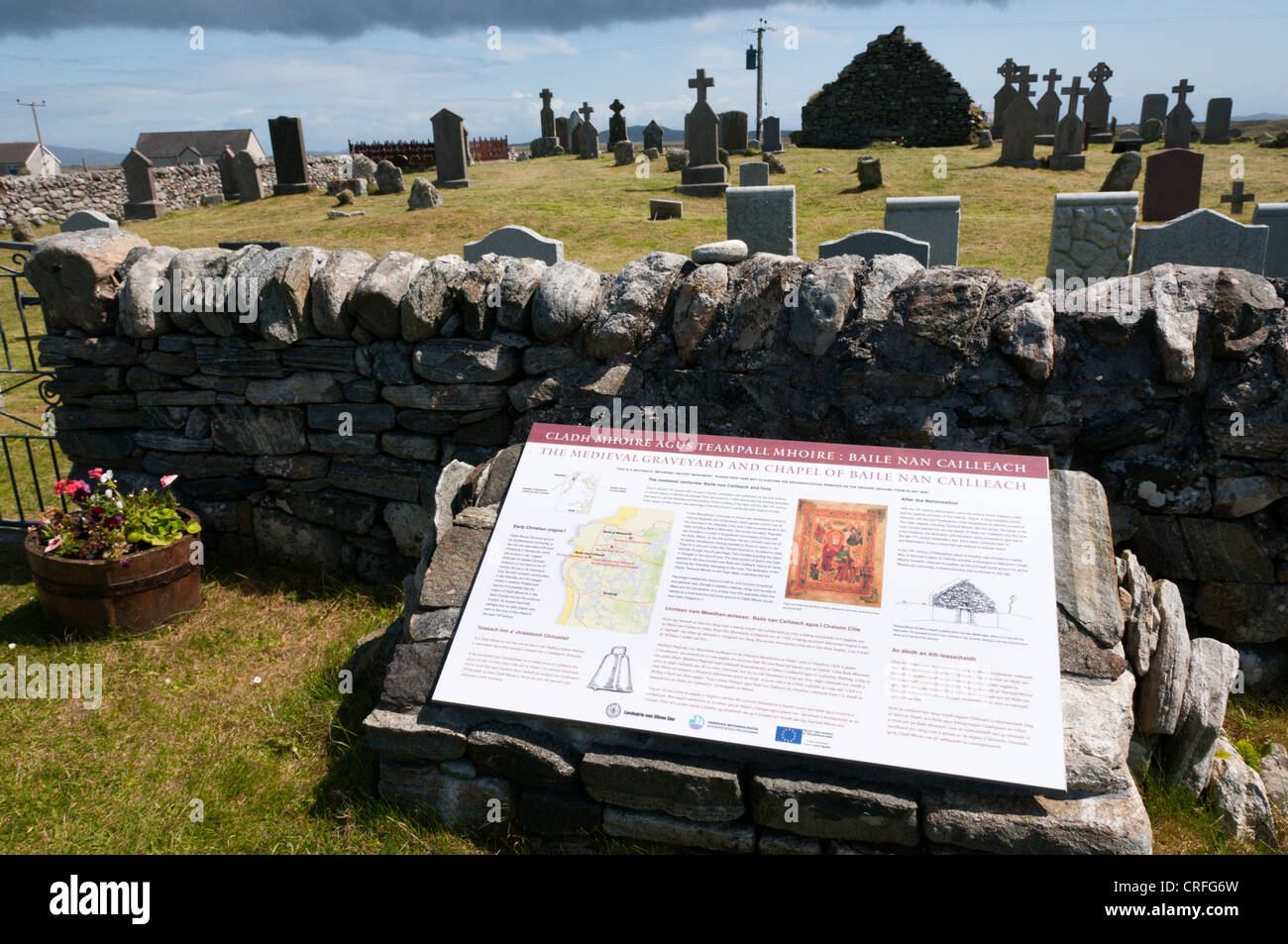 An interpretative sign at Cladh Mhuire chapel and graveyard on Benbecula in the Outer Hebrides Stock Photo