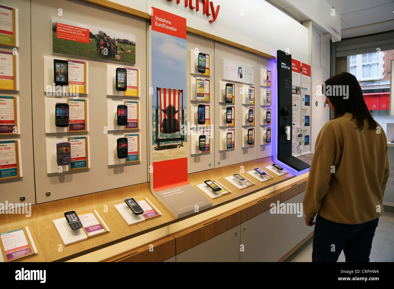 4b2e9265e3f Customer Looking At Mobile Phones In Vodaphone Shop Surrey England ...