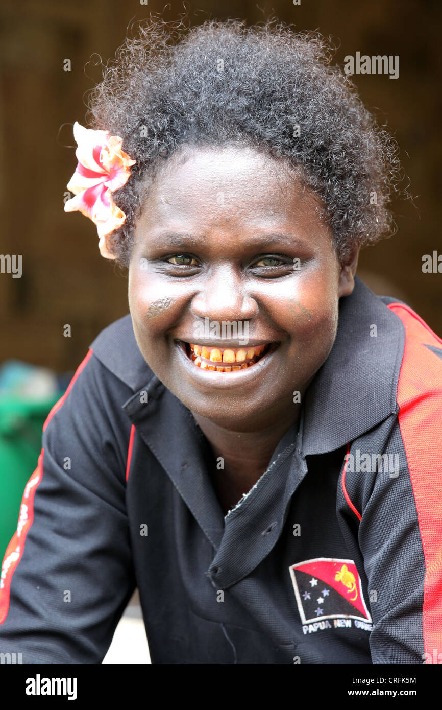 Woman with red teeth from chewing betel nut, on Bougainville Island, Papua New Guinea - Stock Image